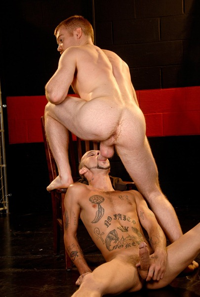 tattooed-gay-swalowing-a-cock
